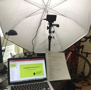 My on-line presentation setup - LED video light, bounced off an umbrella. Logitech webcam right on the top of the laptop screen.
